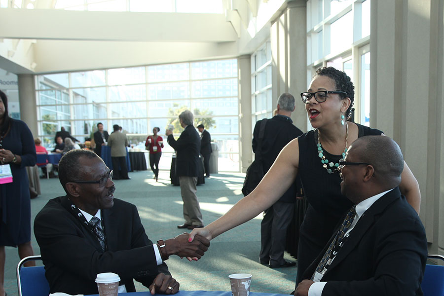 Joset Wright-Lacy (NMSDC) with attendees at the Wednesday Networking Breakfast