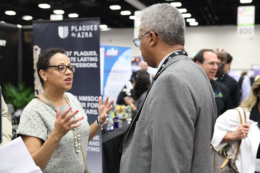 Joset Wright-Lacy with attendee at the 2015 Business Opportunity Exchange