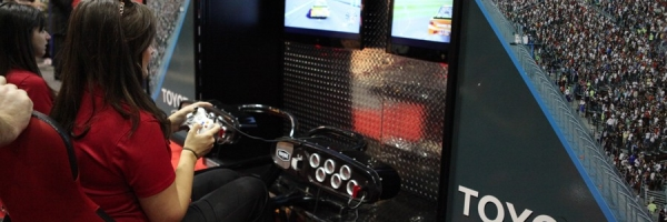 Guest who visited the Toyota booth put the pedal to the metal at the racing simulator.