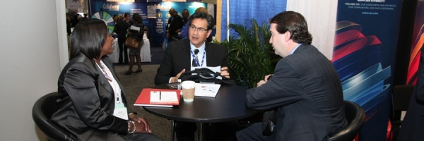 Johnson & Johnson representatives discuss their supplier diversity opportunities with a trade show attendee.
